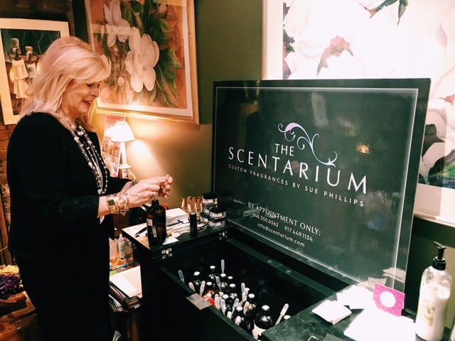 Sue Phillips Scentrepreneur mixing custom fragrances